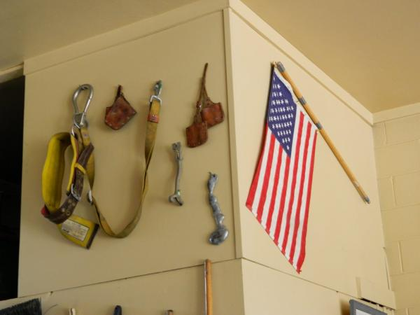 Station 15 - Tools and American flag hanging on wall