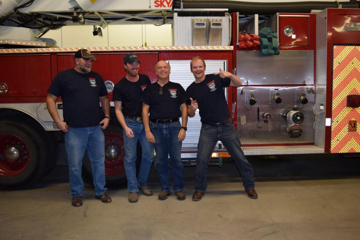 Group photo in front of fire truck
