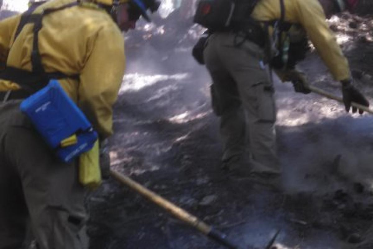 Firefighters use pickaxes